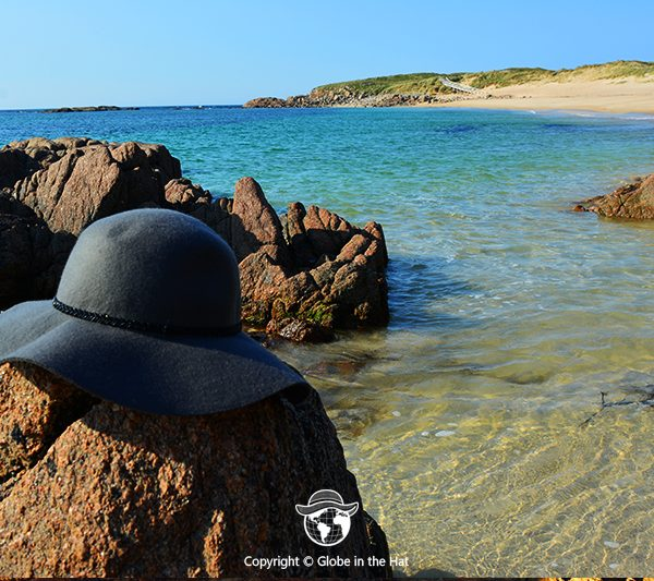 Globe in the Hat by the ocean
